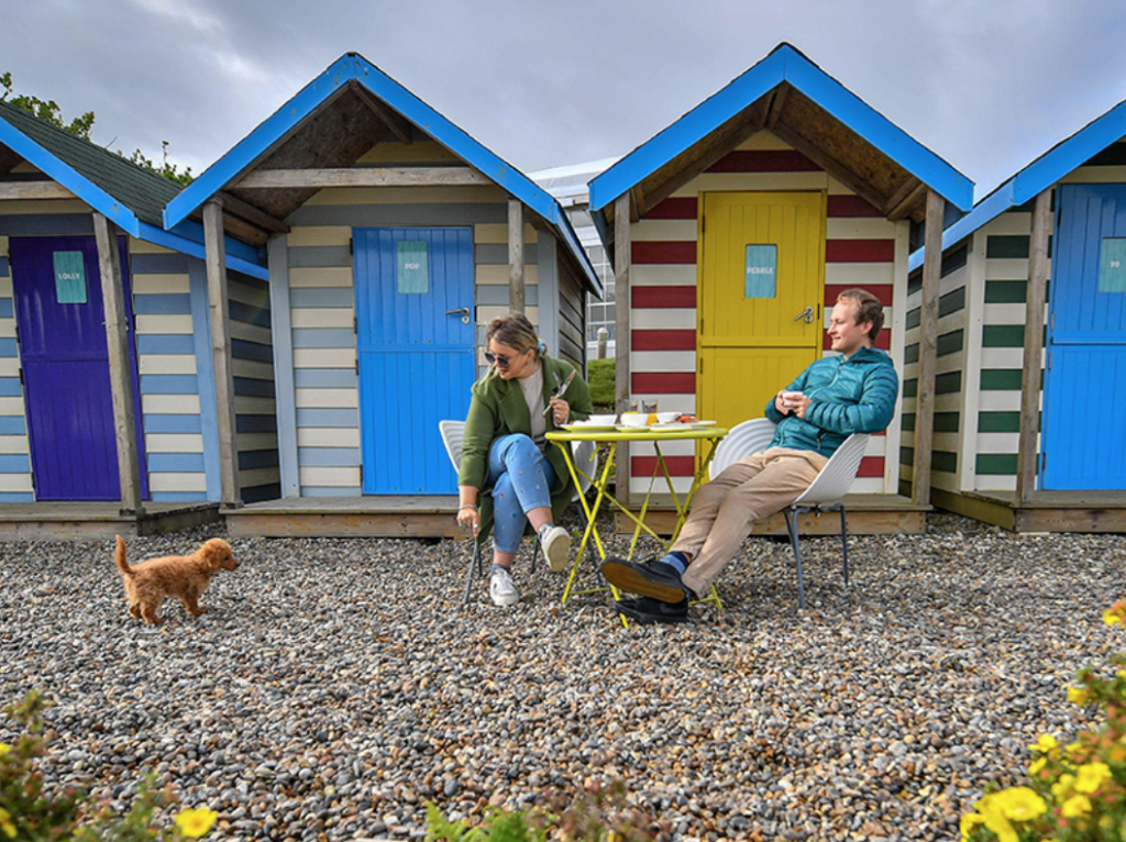 Beach huts on a private stretch of Cornwall's coastline transformed into secluded dining rooms