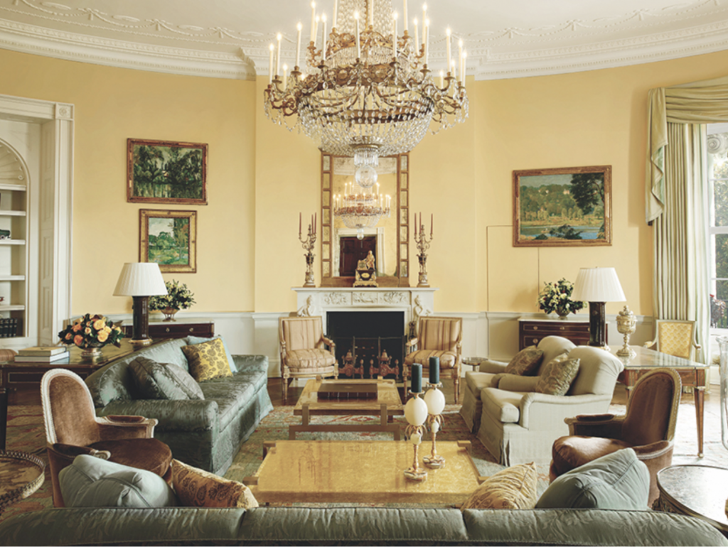 The Yellow Oval Room, with its soaring ceilings, featured paintings by Paul Cézanne (left) and Daniel Garber from the White House collection, and antique toys from the Smithsonian. Image: Michael Mundy